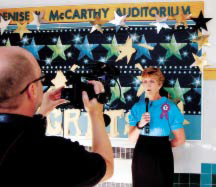 Emily G. Wetherbee School Director, Colleen Lennon, bearing the #1 seal, speaks to LPS-TV about the school's success in the most recent MCAS tests.