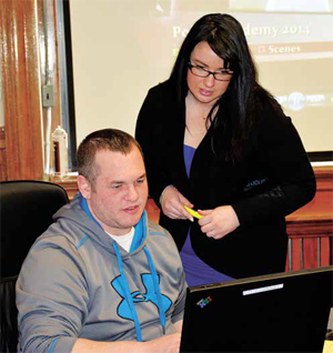 Kate Reilly, Special Assistant to Mayor Dan Rivera, helping Michael Pharr with his application.