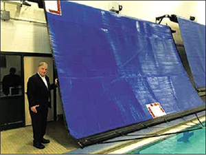 Mayor Fiorentini in front of the new energy saving high school pool cover.