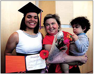 Destiny Morton with Beth E. Anderson, chief executive officer of Phoenix Academy Charter Network on her graduation day June 10, 2015. A total of 11 students acquired a high school diploma