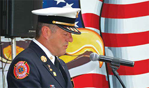 Lawrence Fire Department Chief Brian Moriarty recited The Eleventh of September, a poem authored by Roger J. Robicheau.