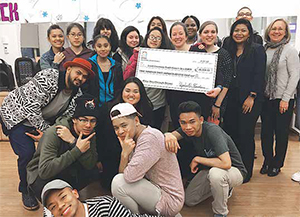 The Lowell CHC Developing Leaders Council members Beth Knudson, Shalmai Rivera and Sokhom Chun present a check for $4,378 in proceeds from their December Winter Mixer to the health center's Teen BLOCK youth program in support of overnight retreats.