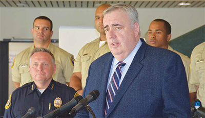 Former Boston Police Commissioner Ed Davis, at the mic, and Police Chief James Fitzpatrick, during the press conference.
