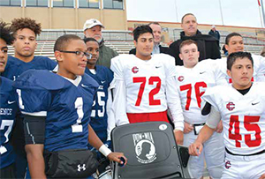 Some of the football players of Lawrence High School and Central Catholic High School were invited to participate at the unveiling. Standing behind them from left, Andy Jimenez, father of Alex Jimenez; John MacDonald of The National Veterans Foundation and Council Vice-president Marc Laplante.