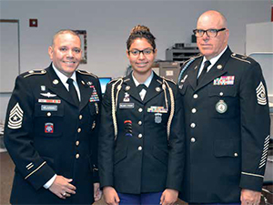 Sgt. Major Jose Velazquez during his tour of the new high school with Rashely Polanco Payano and Sgt. Major Paul Ronan.